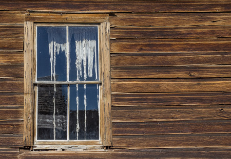window curtains: Window and ripped curtains of a house in Bodie State Historic Park, USA