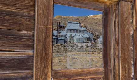 goldmine: Reflection of old factory in Bodie State Historic Park