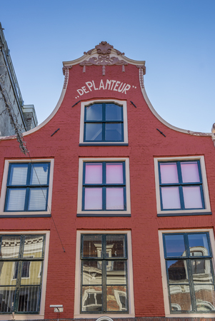 building monumental: Old red house in the center of Leeuwarden, Netherlands Editorial