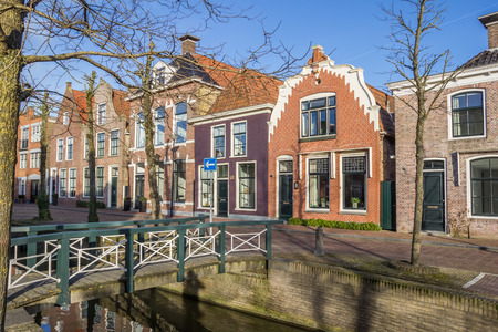 Colorful houses and a bridge at a canal in Franeker, Netherlands