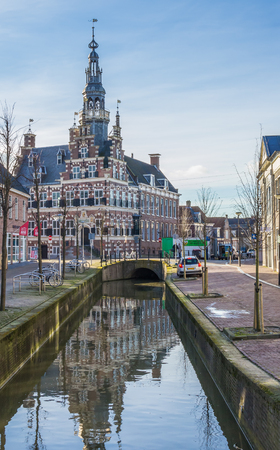Historical town hall along a canal in Franeker, Netherlands