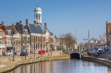 Town hall at a canal in historical Dokkum, Netherlands
