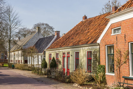fortify: Old houses in a street in Oudeschans, Holland Stock Photo