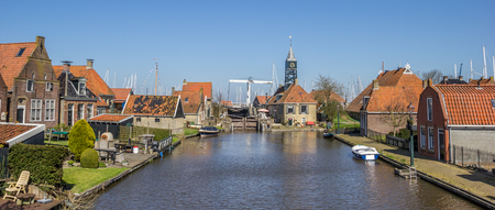 Harbor and lock in the historical city Hindeloopen, Netherlands Imagens