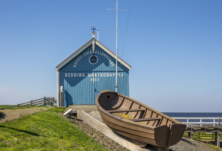 savety: Blue building of the rescue organisation of Hindeloopen, Netherlands