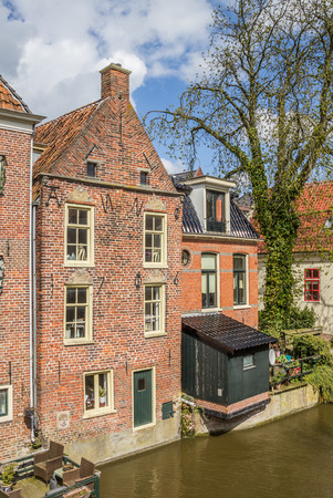 overhang: Old houses along a canal in Appingedam, Netherlands