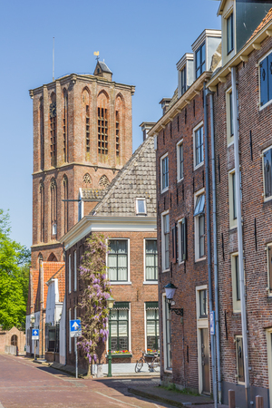 nicolaas: Church tower in a street in historical Elburg, Netherlands