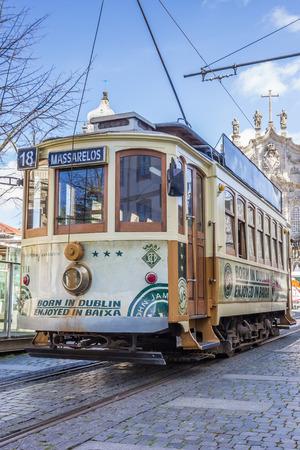streetcar: Streetcar in front of a church in Porto, portugal Editorial