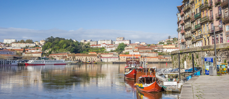 quay: Panorama of boats at the Ribeira quay in Porto, Portugal
