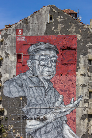 wall mural: Wall mural in the Portuguese city of Porto by street artist Frederico Draw Editorial