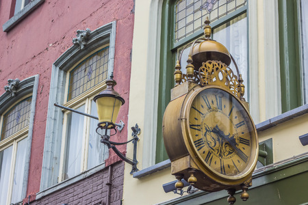 old center: Old street clock in the old center of Nijmegen, Holland Stock Photo
