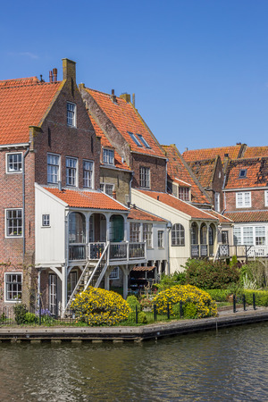 noord: Old houses around the harbor in Enkhuizen, Holland Editorial
