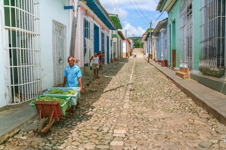 streetlife: Old man with a cart of vegetables on a cobblestoned street in Trinidad, Cuba
