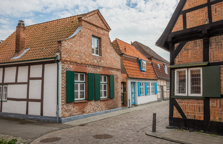 trave: Narrow cobblestoned street with small houses in Travemunde, Germany