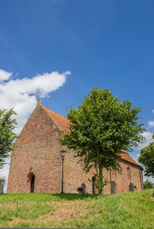 Church on a hilltop in Ezinge, The Netherlands