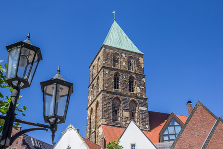Street light and church tower in Rheine, Germany