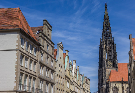 church tower: Facades and church tower at the Principal market square in Munster, Germany Stock Photo