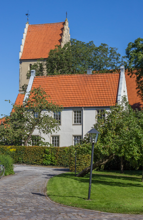 westfalen: House and church tower in Steinfurt, Germany