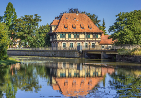 westfalen: Watermill building with reflection in the water in Steinfurt, Germany Editorial