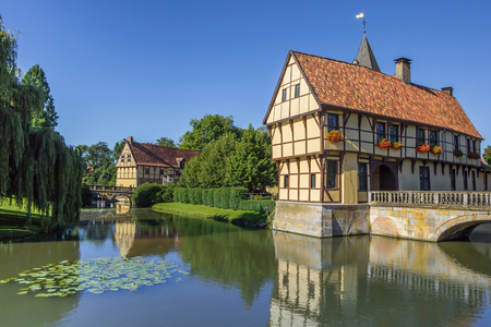 Entrance house of the Steinfurt castle with reflection in the water Editorial