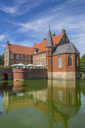 westfalen: Burg Hulshoff with reflection in the water near Havixbeck, Germany Editorial