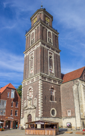 westfalen: Coctailbar and church tower on the square in  Coesfeld, Germany