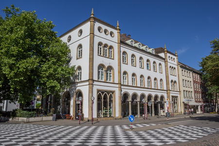 Checkerboard pattern in front of an old building in Osnabruck, Germany