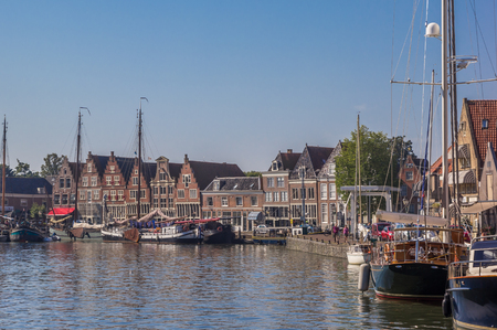 hoorn: Boats and old houses in the harbor of Hoorn, Netherlands