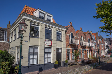 hoorn: Cobblestoned street with old houses in the harbor of Hoorn