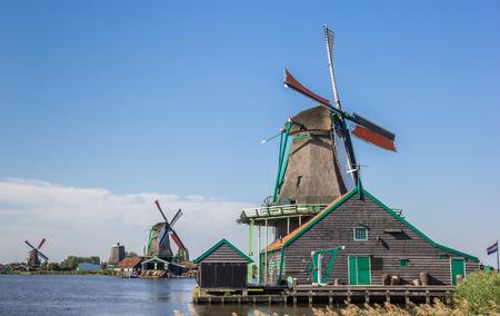 zaan: Traditional dutch windmills at the Zaan river in Zaanse Schans, Holland Editorial