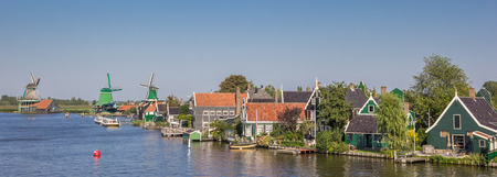 zaan: Panorama of the Zaan river with historical houses and windmills at the Zaanse Schans, Holland