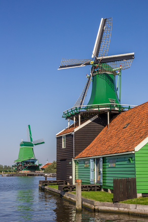 Traditional dutch windmills at the Zaan river in Zaanse Schans, Netherlands