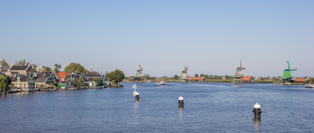 zaan: Panorama of the Zaan river with historical windmills at the Zaanse Schans, Holland Stock Photo
