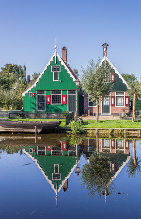 Little dutch houses of Zaanse Schans, Holland with reflection in the water