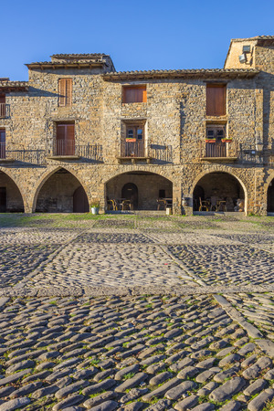 central square: Houses at the central square in Ainsa, Spain Editorial