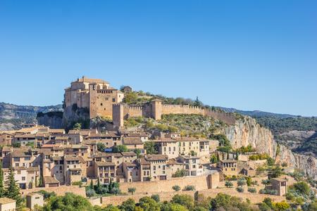Castle above mountian village Alquezar in the Pyrenees, Spain Editorial
