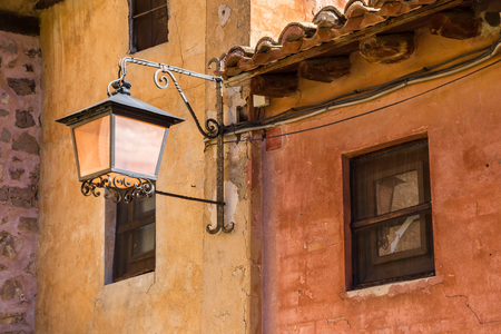 Street light on colorful houses in Albarracin, Spain