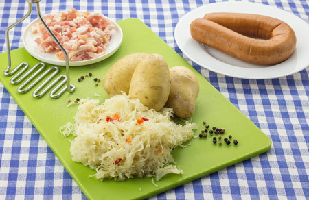smoked sausage: Ingredients for typical dutch dish zuurkool with sauerkraut, smoked sausage, bacon and potatoes