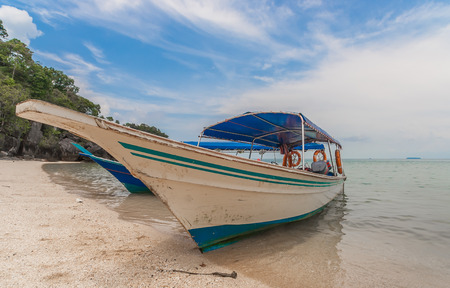 Traditional wooden boat at the beach of Langkawi island, Malaysia