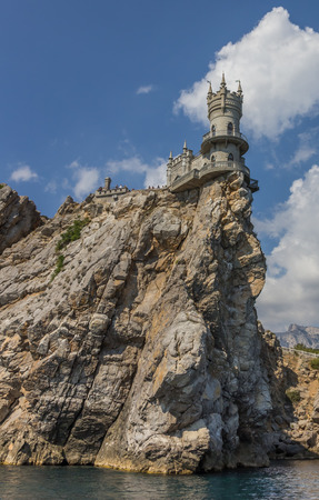 Swallows nest on top of a cliff near Yalta, Russia