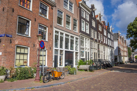 Zandhoek street with traditional houses in Amsterdam, Netherlands Editorial