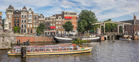 Tourists taking a river cruise in Amsterdam, Holland