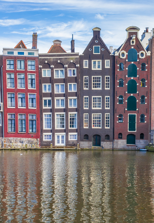 Colorful houses at the Damrak in Amsterdam, Holland