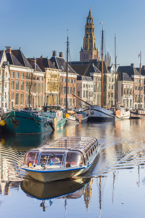 Cruiseboat on a tour through the canals of Groningen in The Netherlands Editorial