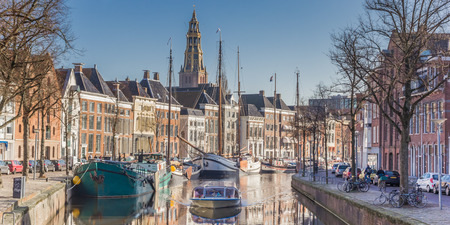 Panorama of a cruiseboat in a canal in Groningen, The Netherlands