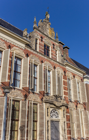 Old decorated facade with blinds in Groningen, Holland