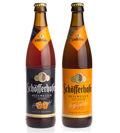 Bottles of Schofferhofer German white and dark wheat beer isolated on a white background