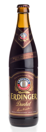 Bottle of Erdinger german dark wheat beer isolated on a white background Editorial