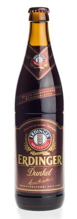 Bottle of Erdinger german dark wheat beer isolated on a white background Editorial