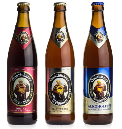 Bottles of German Franziskaner wheat beer, isolated on a white background